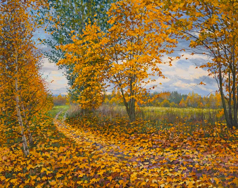 trees with orange leaves and autumn leaves on the ground