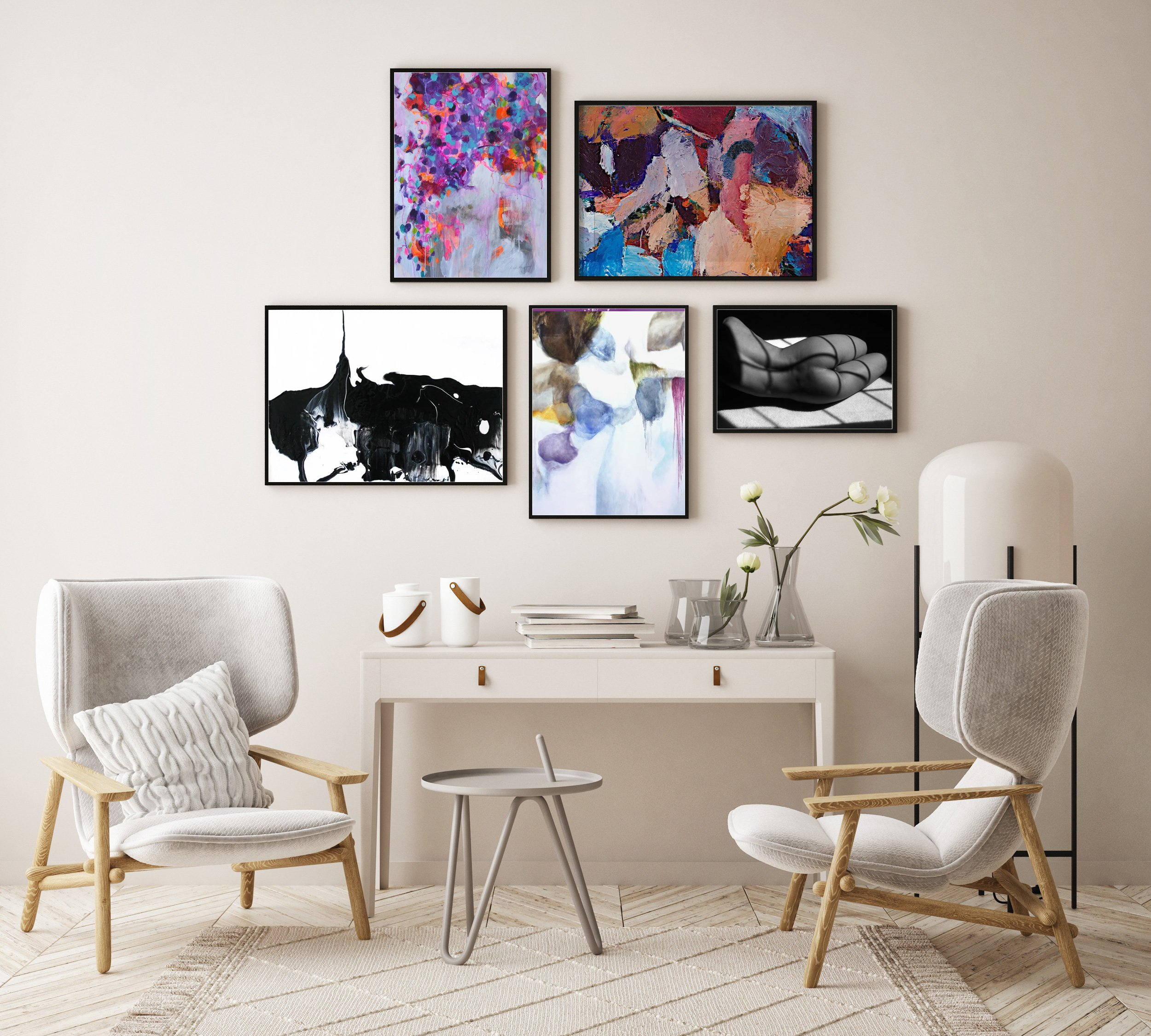 gallery wall above table and chairs with mix of artwork abstracts and photographs